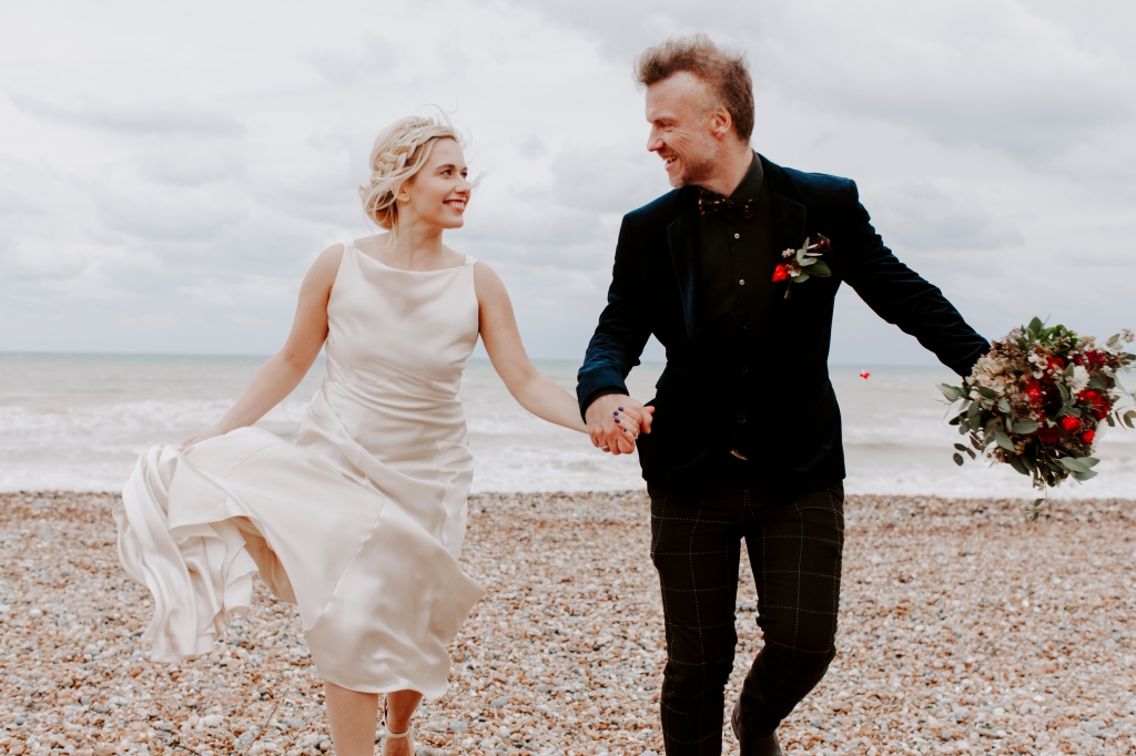 Bride and groom on the beach in Whitstable Kent
